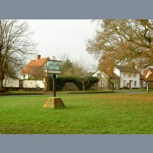 Redgrave sign looking toward houses